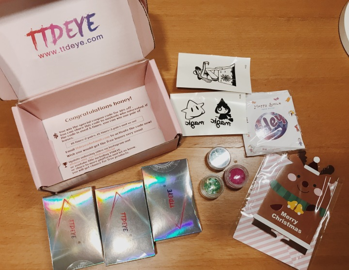 TTDeye contacts packaging! Includes freebies like a mirror, glitter, temp tattoos, and stickers.
